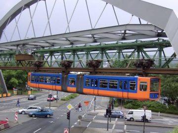 Wuppertaler Schwebebahn Floats Over An Intersection