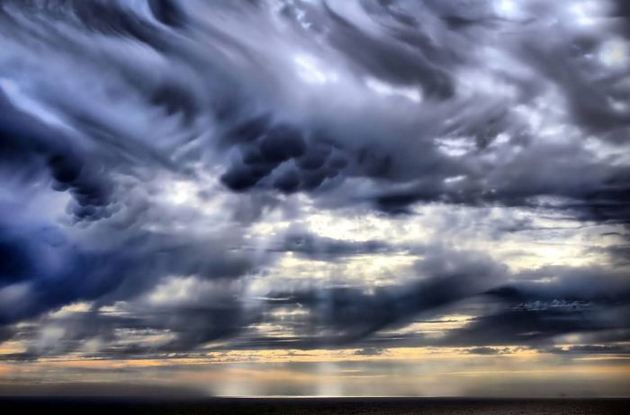 Mammatus Clouds And Crepuscular Rays