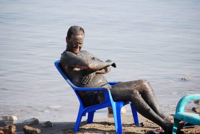 A Guy Enjoying A Mud Bath